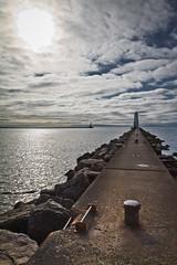 Frankfort Light (ETCphoto) Tags: sky sun clouds pier rocks post lakemichigan ladder 0474 frankfortlighthouse