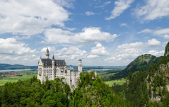 Castle of Neuschwanstein - [EXPLORED] (andreaskoeberl) Tags: trees alps green castle tourism nature grass clouds germany landscape bavaria nikon forrest hill landmark palace neuschwanstein hohenschwangau marienbrcke famousplace 1685 d7000 nikon1685 nikond7000 andreaskoeberl