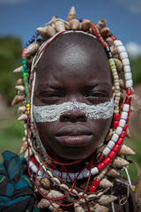 little boy with his face painted and shell necklace around the neck of the Mursi tribe (anthony pappone photography) Tags: africa travel boy portrait baby color boys colors face barn digital canon lens photography facepainting photo eyes colorful colours colore foto child faces image expression retrato african picture culture unesco portraiture afrika omovalley bodypainting fotografia ethiopia ritratto mursi reportage photograher afrique barna bambino faccia eastafrica phototravel facepainted etiopia etnic 非洲 etnico ethiopie etnia bodypainted アフリカ loweromovalley etnica etnologia afryka childrentravel etiopija portraitsofchildren mursitribe 아프리카 etiopien etiópia africantribe африка etiopi eos5dmarkii mursy अफ्रीका childrenbestphotos lowervalleyoftheomo lowervalleyomo