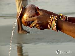 To him....DSC07764 (subirbasak) Tags: people india water horizontal holding hands religion ring celebration bangle spirituality hinduism sari pouring westbengal traditionalfestival indianculture pouringwater gangasagar subirbasak incidentalpeople traditionalritual