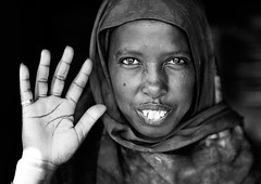 (Constantine Savvides) Tags: hello africa portrait blackandwhite female eyes eyecontact hand open feminine teeth muslim islam hijab wave palm portraiture afrika hi somali welcome connection somalia islamic somaliland afrique hornofafrica moslim muslimwoman africanwoman somalie palmofhand villagewoman somaliwoman handpalm africanmuslim balligubedle