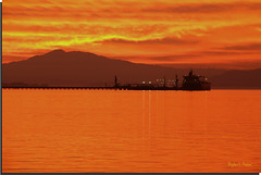 Firey Tendrils, Golden Orange Seas [✥Explored✥] (SteveFrazierPhotography.com) Tags: california sunset sky orange usa mountain reflection water beautiful yellow clouds landscape photography lights bay photo ship photographer unitedstates sundown image picture vessel surface terminal calm photograph oil serene vallejo tranquil strait mounttam tanker fiery mounttamalpais waterscape carquinez sanpablobay 60d canoneos60d
