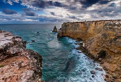 Cabo Rojo (GOJR.) Tags: ocean cliff seascape beach nature clouds landscape island coast rocks waves puertorico waters caribbean caborojo searocks playasucia boqueron nikon1224mm farodecaborojo nikond300s hoyahmcclpl