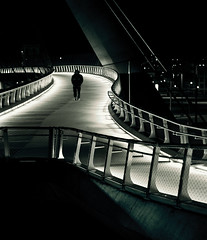 The Crossing (Greg Adams Photography) Tags: bridge winter light man monochrome sepia night walking person sandiego rail stranger structure hvcc 2011 3rd1412 hhsc2000
