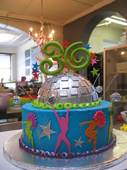 Wicked Chocolate cake iced in blue butter icing decorated with half 3D silver Disco Ball, disco dancer silhouettes, silver fondant stars, 3D twirly green #30, wired stars & toy disco balls (Charly's Bakery) Tags: birthday cake disco town dance tv chocolate wicked angels bakery reality cape 30th eighties charlys october2010