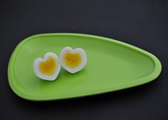 Heart shaped eggs [Explored] (Bhaskar Dutta) Tags: life white black green love yellow project still healthy triangle heart shaped egg plate romance eggs week conceptual 52 yolk albumin motifdchallengewinner eggitarian
