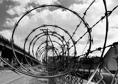 Razor Wire, Eastbound (Ron Scubadiver's Wild Life) Tags: houston texas industrial razor wire fence nikon east end