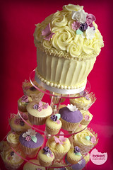 Cream Cupcake Tower by Baked Cupcakery (Baked. Cupcakery) Tags: pink wedding white flower tower butterfly giant cupcakes purple cream cupcake