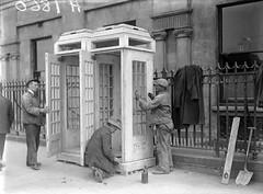 Telephone Boxes (National Library of Ireland on The Commons) Tags: ireland dublin hat 1932 thirties 1930s workmen caps shovel pt railings romancatholic telephones overall overcoat leinster oconnellbridge telephoneboxes spiritlevel nationallibraryofireland eucharisticcongress ballasthouse locationidentified independentnewspaperscollection postsandtelegraph