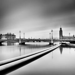 City Lines 2.0 (Peter Levi) Tags: city longexposure bridge sea sky blackandwhite bw blancoynegro water clouds sweden stockholm cityhall le stadshuset travellingclouds absoluteblackandwhite bestcaptur