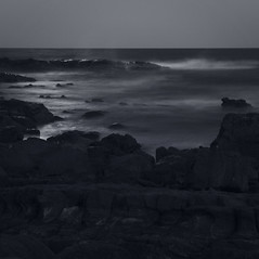 Moonlight ({JO}) Tags: ocean longexposure sea bw beach blackwhite rocks coastal tinted coolum pointarkwright