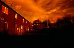 Redscale Beckhill Estate (Saturated Imagery) Tags: red silhouette 35mm fire iso200 epson praktica dereliction meanwood v500 filmslr vivitar28mmf25 beckhillestate prakticatl5b lomographyredscalexr devlopedthephotoshop urbanairsunsetsandskiesofleeds