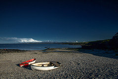 Moelfre Boats (dilys_thompson) Tags: sea beach wales boats bay coast bluesky rowing anglesey northwales moelfre