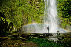 Rainbow and Rasta at the Waterfall (B.Bubble) Tags: green wet silhouette river waterfall rainbow dock bright availablelight ghana westafrica lpbright wilifalls