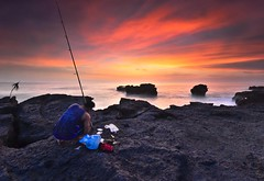 patience... (Dyahniar Labenski) Tags: sunset sky bali rock stone indonesia fishing fisherman nikon asia patience 1024mm d7000 mengeningbeach dyahniar