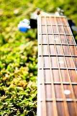 Six Strings on Grass (upake) Tags: music blur grass guitar yamaha strings tune sixstrings