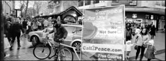 Catch-22 (*monz*) Tags: life street blackandwhite bw panorama streets film bike bicycle sign poster joseph 22 birmingham peace message centre trix rangefinder philosophy 11 spot panoramic hasselblad filter catch push heller xpan f4 45mm iso1600 brum 20c catch22 csf xtol monz 125m 2stop