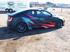 Matte black vehicle wrap - gloss overlay - scion - passenger (Soapoint Graphics) Tags: sign promotion mobile advertising design marketing graphics display vinyl murals wrap company printing installation shuttle signage format lettering banners custom decals largeformat tradeshow sponsor fabricate wallmural businesssign lightedsign advertisingdesign outdooradvertising vehiclewrap standups buswrap largeformatprinting matteblack printedtshirt mobilemarketing customdesign cardecal businessdesign carwrap autowrap boatwrap vanwrap mobilebillboard vehiclegraphics customprint customsignage motorcyclewrap truckwrap trailerwraps suvwrap racecarwrap customfabrication customcarwrap popupdisplay silkscreenedtshirt graphicwrap fleetvehiclewraps printedgraphics printedclothing backlitgraphic graphicsadvertising flatblackwrap racewrap carwrapinstallation letteringdecal largebuildingsign customsignfabrication signcabinet 3mcertifiedinstall 3mperfered