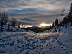 Goldenhorn_PC278110-HDR 2 (yukonchris) Tags: winter sunset sun mountain snow canada forest north yukon northern hdr whitehorse intothesun borealforest northof60 winterroad skyglow zuiko1454mm goldenhornmountain cans2s olympuse30 tripodphotography