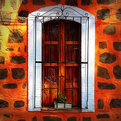 """leapin' leopards, daddy warbucks!"" (msdonnalee) Tags: house window architecture facade buildings ventana casa arquitectura iron niceshot fenster wroughtiron finestra pottedplant shutters janela ironwork fachada fentre stucco finestre venster leopardspots littleorphanannie ironwindowgrill spottedfacade leapinleopards"