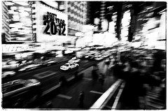 Happy New Year  2012 (f1design) Tags: nyc bw newyork blackwhite manhattan taxi highcontrast timessquare panning 11mm bwphotography newyorkny happynewyear 2012 slowshutterspeed f1design