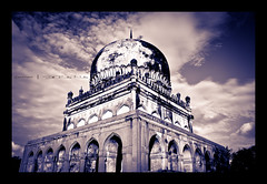 One cannot and must not try to erase the past merely because it does not fit the present. (shub.rana) Tags: blackandwhite sun india heritage beauty clouds creativity fort tomb creative oldbuildings mosque hyderabad monuments southindia andhrapradesh monotones qutbshahitombs
