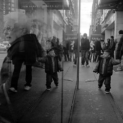 bus stop (Barry Yanowitz) Tags: nyc newyorkcity blackandwhite bw ny newyork reflection 6x6 film mediumformat reflections blackwhite chinatown kodak manhattan trix 120film d76 scanned filmcamera nycity selfdeveloped kodaktrix400 rolleicordv selfdeveloping d76developer whysoserious nprfilm