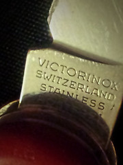Gulliver studies: Victorinox (aistora) Tags: uk red england macro history home mobile closeup digital pen army reading switzerland phone personal zoom swiss steel sony sonyericsson knife cellphone icon sharp elements experience crop worn resolution aged pocket brand iconic android stainless 8mp wornout topaz 25years x10 zoomin victorinox penknife pixelate swissarmyknife inox rostfrei maistora xperia