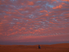 Sunset in Sahara (Evgeni Zotov) Tags: africa sunset red sky people cloud man sahara landscape fire evening twilight sand alone loneliness desert dusk walk apocalypse walker maghreb lonely moor mauritania mauritanie mauretanien mauretania mauritani chinguetti mauritnia  adrar     moritanya   darraa
