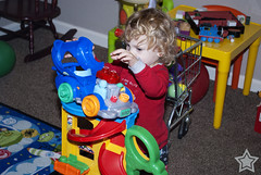 Looking Under the Hood ([ the black star ]) Tags: boy playing table toys photography toddler hand floor engine shoppingcart things kingston stuff pjs hood rockingchair blondehair shrug littlekid toycar pretending playroom tinkering chiars goldenlocks pajammas theblackstar thelittlemister