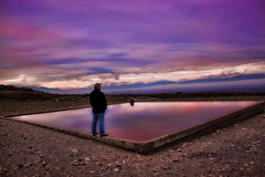 Gazing (Theophilos) Tags: sunset sky man mountains reflection nature water clouds view greece drama gazing