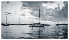 storm rollin' in (laughlinc) Tags: sea bw gulfofmexico water clouds boats boat blackwhite florida widescreen beta sarasota 169 1755mmf28 lr4 nikond80 thechallengefactory laughlinc lightroom4beta