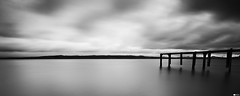 Summer's just around the Corner (#1) (Daniel Wildi Photography) Tags: longexposure lake monochrome clouds switzerland pier jetty hills neuchtel 2012 nationalgeographic staubinsauges saintaubinsauges summersjustaroundthecorner cantonofneuchtel danielwildiphotography