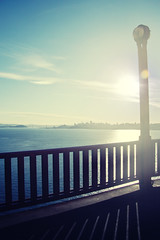 The Gift of Light (Leighton Wallis) Tags: sanfrancisco california birthday ca light shadow usa sun water lamp skyline fence bay cityscape unitedstatesofamerica goldengatebridge 75thanniversary ggnpc11