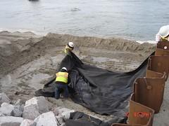 Crews Place Fabric, Then Rocks along the New Metal Sheeting (NCDOTcommunic