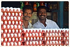 The Egg Guys (The Spirit of the World) Tags: india men shop portraits happy store locals smiles eggs produce joyful vendors southernindia indianmen