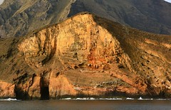 Rock face of a western Galapagos Island. (One more shot Rog) Tags: sea nature volcano scene cliffs galapagos volcanoes volcanicisland volcanic mountans mountainous thegalapagosislands thegalapagos rogersargentwildlifephotography