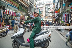Modern guerrillas (Barbara Oggero) Tags: street streetphotography vietnam hanoi traffic scooter vietcong capture city urban candid bike soldier guerrilla guerrillas travel people daylife asia indochina