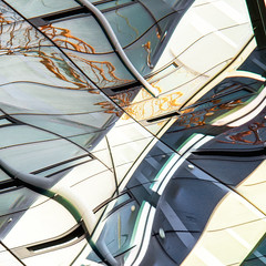Converging Forces.jpg (Dave Obuck - Skypuff) Tags: seattle city sky urban abstract reflection building lines yellow architecture buildings reflections mirror washington construction crane curves growth abstraction density
