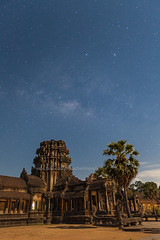Milky Way over Angkor Wat (baddoguy) Tags: blue sky history vertical architecture night photography ancient cambodia antique nopeople angkorwat unescoworldheritagesite palmtree moonlight astronomy celebrities copyspace siemreap angkor ancientcivilization milkyway unusualangle traveldestinations colorimage famousplace artscultureandentertainment siemreapprovince spaceandastronomy templebuilding eastasianculture stonematerial cambodianculture carvingcraftactivity