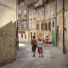 Strolling down the streets of the old city of Ljubljana (Bn) Tags: street old city trip summer people holiday streets men castle history church river walking geotagged graffiti restaurant town women energy europe child market small hill capital sightseeing relaxing scenic atmosphere pedestrian down charm tourist architect slovenia shops ljubljana local baroque wandering beloved laibach strolling ljubljanica top50 lubiana 50faves joe planota plenikits geo:lon=14509512 geo:lat=46050318 plajska