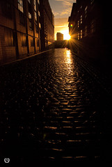 Cobbled Sunrise (Neil Connely) Tags: street sun silhouette architecture clouds sunrise manchester path cobbles starburst ancoats nikond80