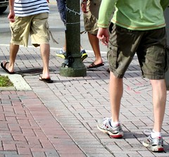 Hoofing it (LarryJay99 ) Tags: street trip vacation people streets male men feet socks walking florida outdoor bricks cargo sneakers sidewalk flipflops shorts hoof streetscape pavers delraybeach tennisshoes footing cargopants anklets hoofing peopleandpaths braghettoni footingit