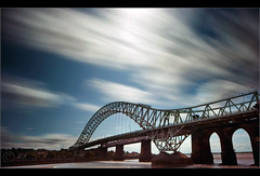 Travelling without moving.. (Chrisconphoto) Tags: longexposure bridge clouds movement runcornbridge weldingglass