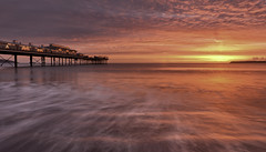 Paignton Pier ([DEVONshots.com] Lloyd W.A. Cosway) Tags: longexposure red sea sun seascape beach clouds sunrise reflections dawn pier nikon devon devonshire d300 paigntonpier devonshots lloydcosway