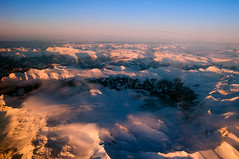 Flying Home for Christmas... (sandrokoster.com) Tags: blue sunset red orange cloud mountain snow plane switzerland twilight pentax jet k20d