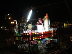 Beverage Boy (Khmer Pure Project) Tags: boy people food shop fruit night kid cambodia khmer child market young business drinks sell phnom penh kampuchea