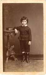 Boy leaning on a table by C. Bender (undated) (pellethepoet) Tags: boy portrait beautiful fashion germany table deutschland book child boots adorable photograph cdv cartedevisite bender junge diez knabe cbender