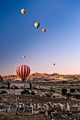 Sunrise balloons flying (Photos On The Road) Tags: sky graveyard rock sunrise turkey landscape outdoors dawn countryside fly alba hill balloon flight scenic ground fairy cielo transportation land float paesaggio cappadocia verticale cimitero cavusin turchia mongolfiere
