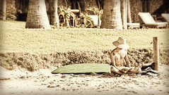All one needs in Paradise is a good book (PrayerSpaces) Tags: travel man beach hat vintage mexico outdoors reading book sunny palmtrees surfboard tatoos vignette banderasbay 2012 loungechairs hss agoodbook prayerspaces patricialwalker